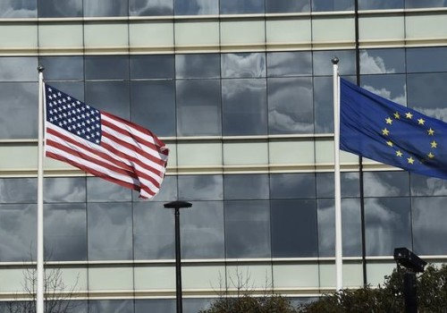 A British Union flag (L), a U.S. flag (C) and an European Union flag are seen flying above offices in London, Britain, March 30, 2016. REUTERS/Toby Melville - RTSCYTF